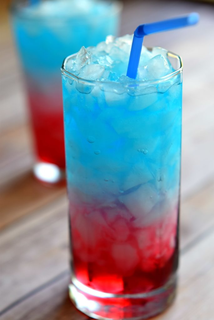 So fun! Learn how to make a layered drink by making this sweet 4th of July layered drink!