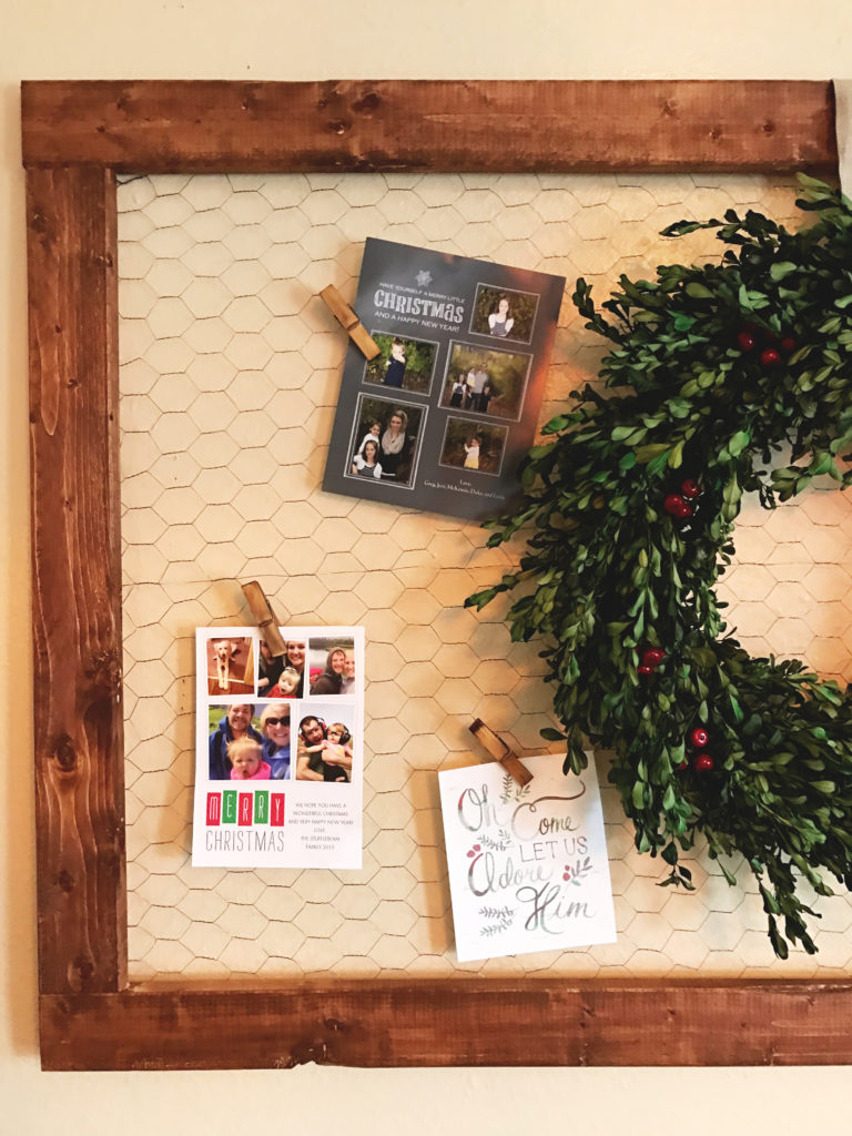 DIY- Create this holiday card holder for under $15. Using chicken wire and stained wood.